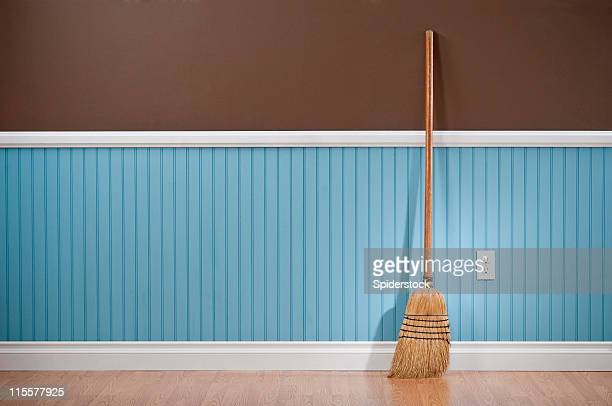 Corn whisk broom standing in empty room