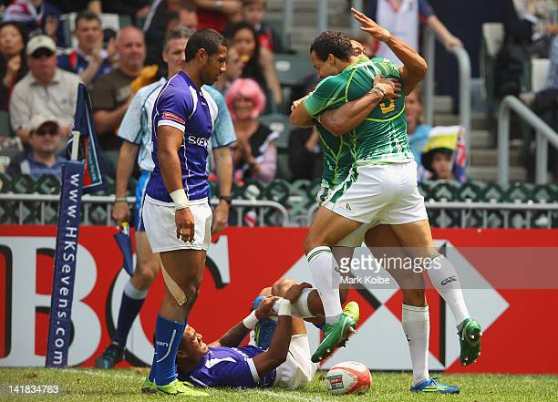 Cornal Hendricks and Paul Delport of South Africa celebrate a try during the match between Samoa and South Africa on day three of the 2012 IRB Hong...