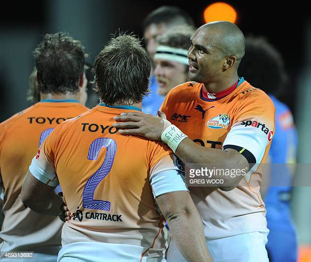 Cornal Hendricks from the Cheetahs congratulates teammates following their win in the Super 15 rugby union match between Australias Western Force and...