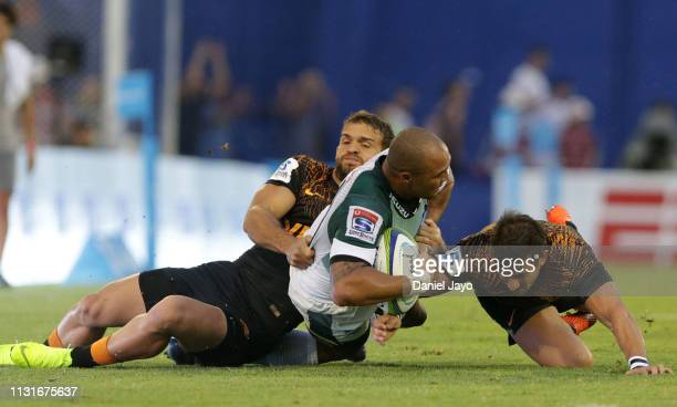 Cornal Hendricks of Bulls is tackled by Javier Ortega Desio and Joaquin Diaz Bonilla of Jaguares during the Super Rugby Rd 2 match between Jaguares...