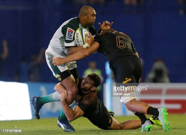 Cornal Hendricks of Bulls is tackled by Ramiro Moyano and Pablo Matera of Jaguares during the Super Rugby Rd 2 match between Jaguares and Bulls at...