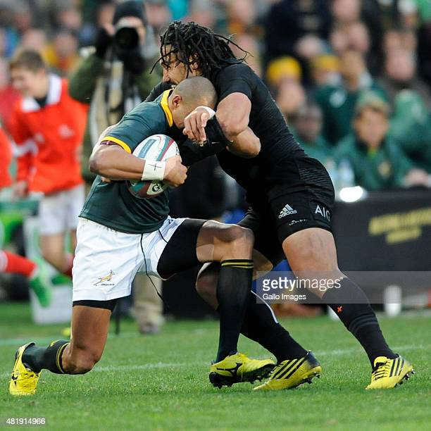 Cornal Hendricks of South Africa and Ma'a Nonu of New Zealand in action during The Castle Lager Rugby Championship 2015 match between South Africa...