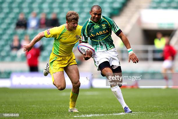 Cornal Hendricks of South Africa breaks away from Sam Figg of Australia during the Marriottt London Sevens Day One at Twickenham on May 11 2013 in...