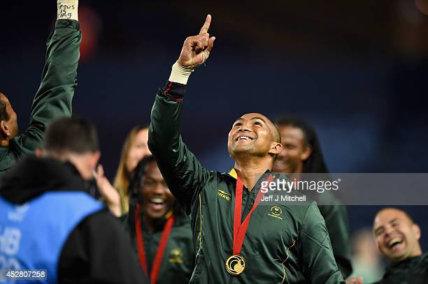 Cornal Hendricks of South Africa celebrates after winnig the gold medal match in the rugby sevens at Ibrox Stadium during day four of the Glasgow...