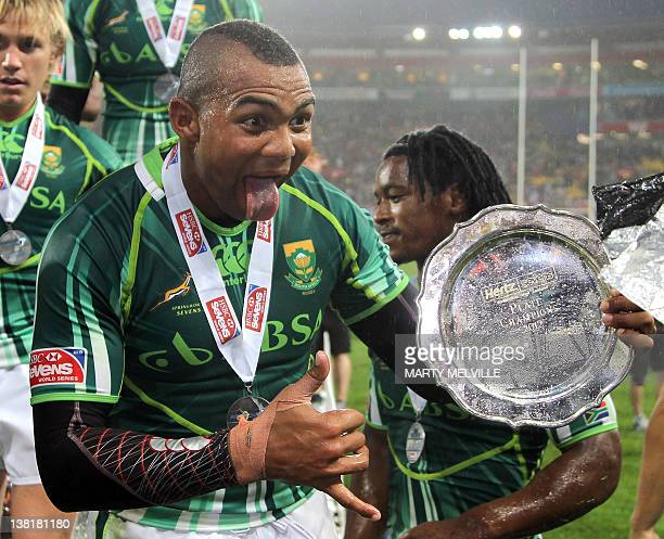Cornal Hendricks of South Africa celebrates their plate win over Tonga at the Rugby Sevens tournament in Wellington on February 4 2012 AFP PHOTO...