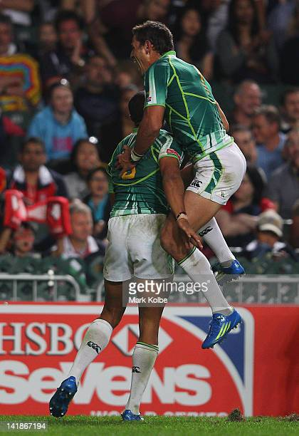 Cornal Hendricks of South Africa celebrates with Chris Dry of South Africa after scoring a try during the third place playoff match between South...