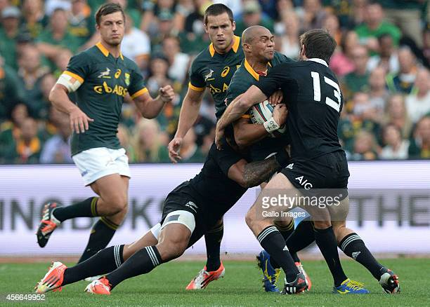Cornal Hendricks of South Africa gets tackled during The Castle Rugby Championship match between South Africa and New Zealand at Ellis Park on...