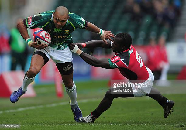 Cornal Hendricks of South Africa holds off Michael Wanjala of Kenya during the IRB Glasgow Severns at Scotstoun Stadium on May 4 2013 in Glasgow...