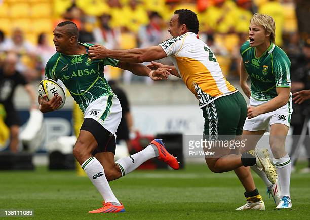 Cornal Hendricks of South Africa is tackled by Jamie Makara of the Cook Islands during the game between South Africa and the Cook Islands on day one...