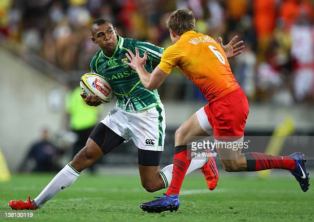 Cornal Hendricks of South Africa is tackled by Tom Mitchell of England during the game between England and South Africa on day one of the Wellington...