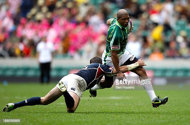 Cornal Hendricks of South Africa is tackled by Zach Test of the USA during the Marriottt London Sevens Day One at Twickenham on May 11 2013 in London...