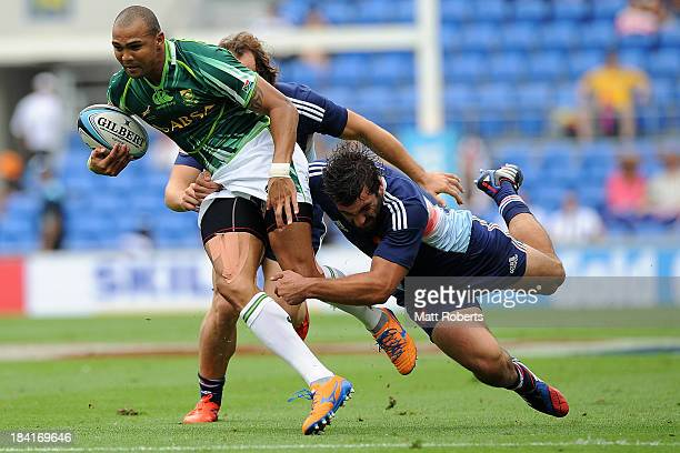 Cornal Hendricks of South Africa is tackled during the Gold Coast Sevens round 1 match between South Africa and France at Skilled Stadium on October...