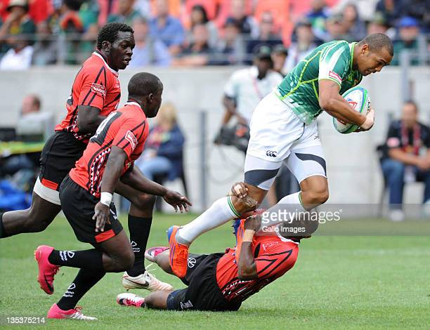 Cornal Hendricks of South Africa is tackled during the match between South Africa and Kenya on day one of the 2011 IRB South Africa Rugby Sevens at...