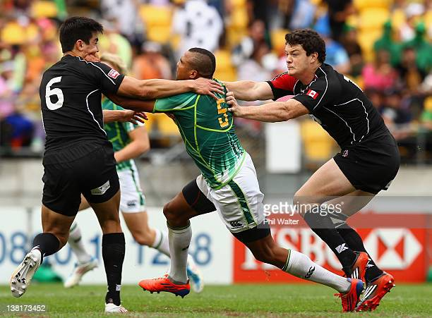 Cornal Hendricks of South Africa is tackled during the match between South Africa and Canada on day two of the Wellington Sevens at Westpac Stadium...