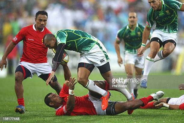 Cornal Hendricks of South Africa is tackled during the Plate Final between South Africa and Tonga on day two of the Wellington Sevens at Westpac...