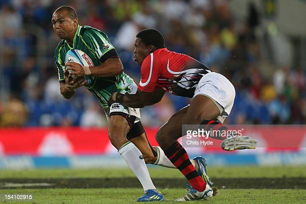 Cornal Hendricks of South Africa is tackled during the third and fourth playoff match between South Africa and Kenya during day two of the 2012 Gold...