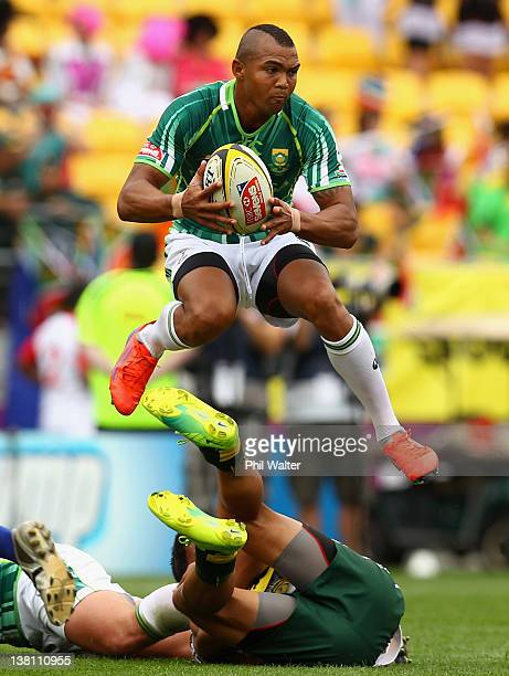 Cornal Hendricks of South Africa jumps a tackler during the game between South Africa and the Cook Islands on day one of the Wellington Sevens at...