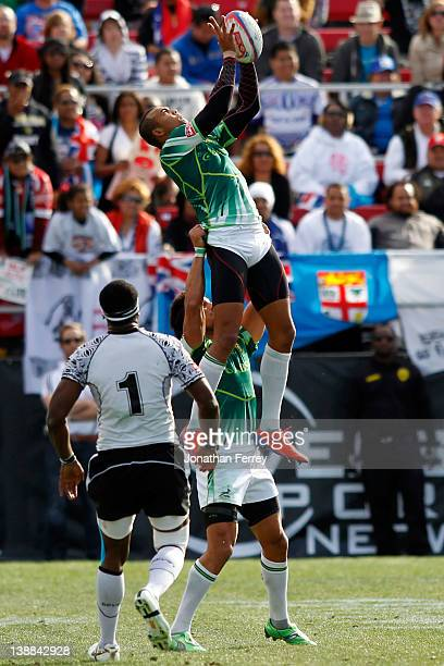 Cornal Hendricks of South Africa jumps for a line out catch against Fiji during battle for third place on day three of the USA Sevens Rugby at Sam...