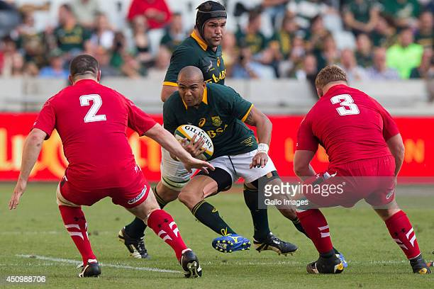 Cornal Hendricks of South Africa Ken Owens and Samson Lee of Wales during the 2nd test match between South Africa and Wales at Mbombela Stadium on...