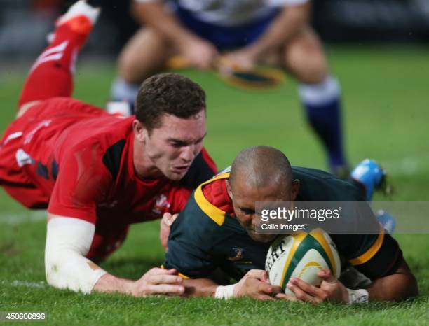 Cornal Hendricks of South Africa over for a try during the Incoming Tour match between South Africa and Wales at Growthpoint Kings Park on June 14...