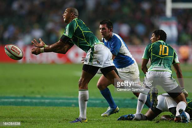 Cornal Hendricks of South Africa passes the ball during the Pool A match between Argentina and South Africa during day one of the 2013 Hong Kong...