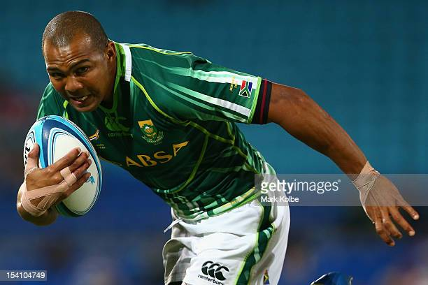 Cornal Hendricks of South Africa runs the ball during the third and fourth playoff match between South Africa and Kenya during the match between on...