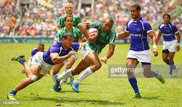 Cornal Hendricks of South Africa scores a try during the match between Samoa and South Africa on day three of the 2012 IRB Hong Kong Sevens at Hong...