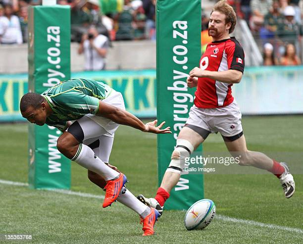 Cornal Hendricks of South Africa scores a try during the match between South Africa and Canada on day one of the 2011 IRB South Africa Rugby Sevens...