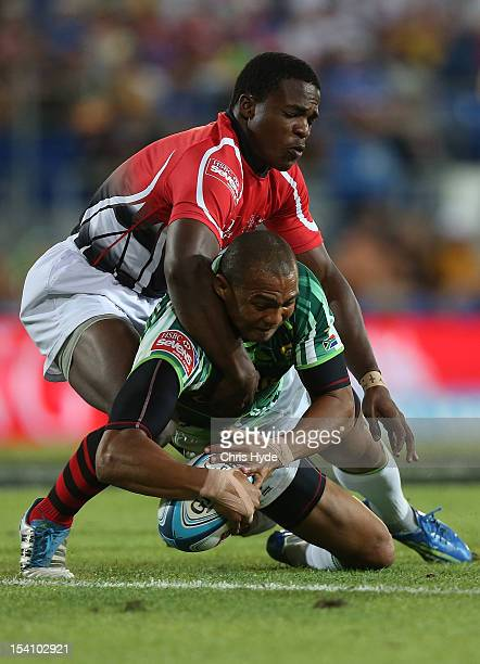 Cornal Hendricks of South Africa scores a try in the third and fourth playoff match between South Africa and Kenya during day two of the 2012 Gold...