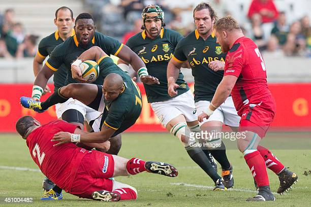 Cornal Hendricks of South Africa tackled by Ken Owens of Wales during the 2nd test match between South Africa and Wales at Mbombela Stadium on June...