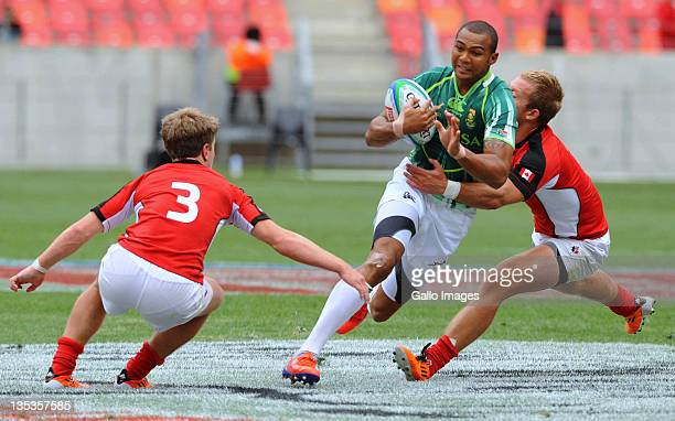 Cornal Hendricks of South Africa tackled by Lucas Hammond and Sean Duke of Canada during the match between South Africa and Canada on day one of the...