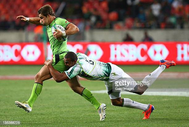 Cornal Hendricks of South Africa tackles Greg Jeloudev of Australia during the match between South Africa and Australia on day one of the 2011 IRB...
