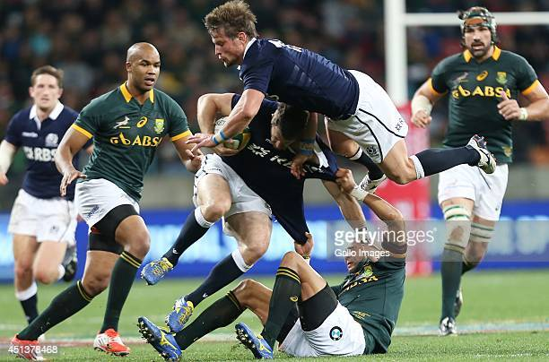 Cornal Hendricks of South Africa tackling Tommy Seymour as Peter Horne of Scotland falls over the top of them during the Incoming Tour match between...