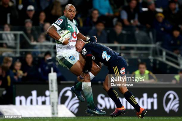 Cornal Hendricks of the Bulls is tackled by Aaron Smith of the Highlanders during the round 17 Super Rugby match between the Highlanders and the...