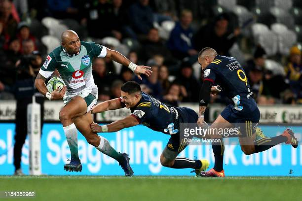 Cornal Hendricks of the Bulls is tackled by Patelesio Tomkinson of the Highlanders during the round 17 Super Rugby match between the Highlanders and...