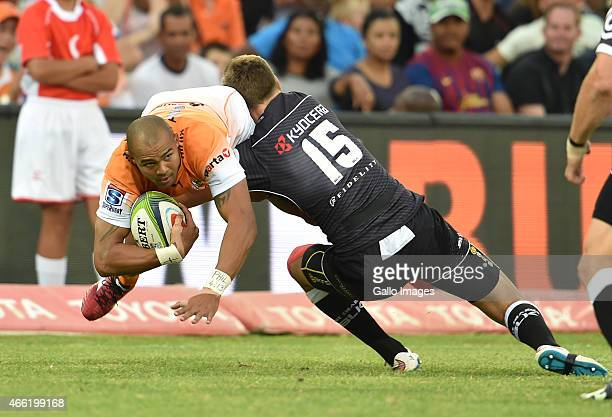 Cornal Hendricks of the Cheetahs getting tagged by SP Marais of the Sharks during the Super Rugby match between Toyota Cheetahs and Cell C Sharks at...
