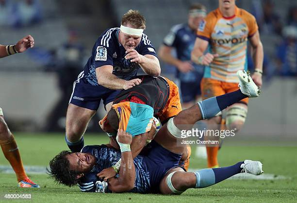 Cornal Hendricks of the Cheetahs is caught by Steven Luatua and Tom McCartney of the Blues during the round six Super Rugby match between the Blues...