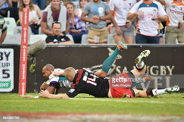 Cornal Hendricks of the Cheetahs scores a try tackled by Johnny McNicholl of the Crusaders during the Round 9 Super Rugby match between Toyota...
