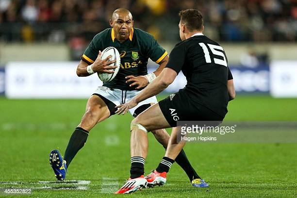 Cornal Hendricks of the Springboks attempts to evade the defence of Israel Dagg of the All Blacks during The Rugby Championship match between the New...