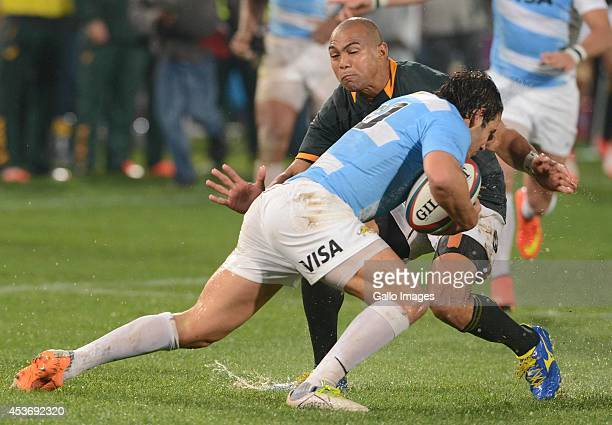 Cornal Hendricks of the Springboks tackles Nicolas Sanchez of Argentina during The Castle Rugby Championship match between South Africa and Argentina...