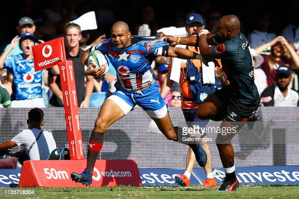 Cornal Hendricks of the Vodacom Bulls hands off Makazole Mapimpi of the Cell C Sharks during the Super Rugby match between Cell C Sharks and Vodacom...