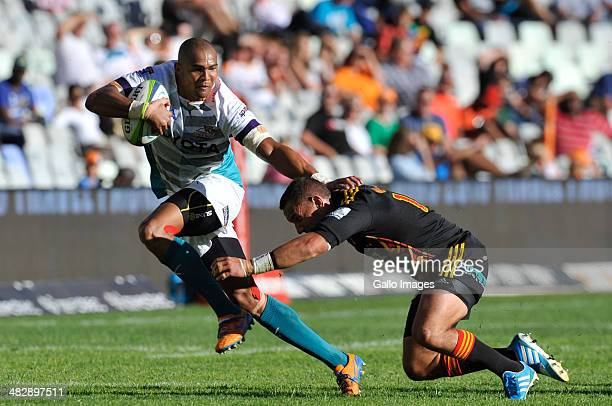 Cornal Hendricks of Toyota Cheetahs is tackled during the Super Rugby match between Toyota Cheetahs and Chiefs at Vodacom Park on April 05 2014 in...