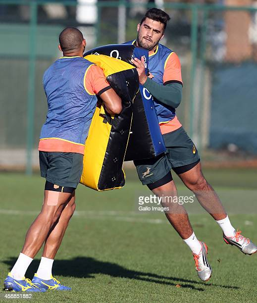 Cornal Hendricks with Damian De Allende in action during the South African National rugby team training session at Latymer Upper School Sports...