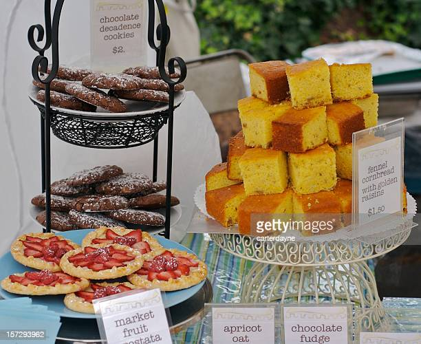 Cornbread and fresh chocolate cookies piled high at Farmers Market