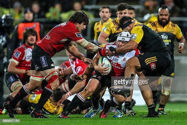 Corne Fourie of the Lions is tackled during the 2016 Super Rugby Final match between the Hurricanes and the Lions at Westpac Stadium on August 6 2016...
