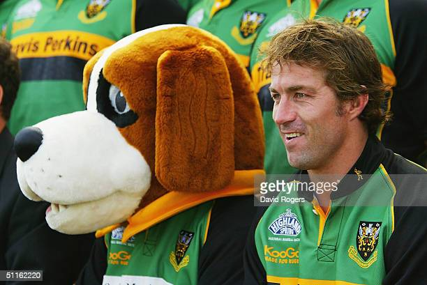 Corne Krige, the former South African Springbok captain pictured with the club mascot during the team photograph at his new club, Northampton Saints...