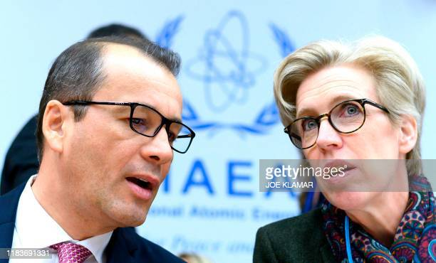 Cornel Feruta , acting Director General of the International Atomic Energy Agency , talks with Mikaela Kumlin Granit, Chairperson of the IAEA Board...