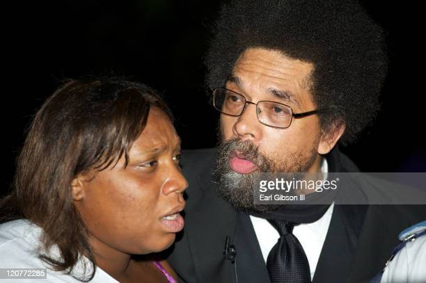 Cornel West talks to a young woman on the streets during the 2011 Poverty Tour on August 9 2011 in Washington DC