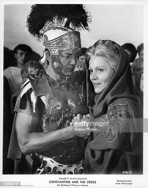 Cornel Wilde holding unidentified woman in a scene from the film 'Constantine And The Cross' 1962