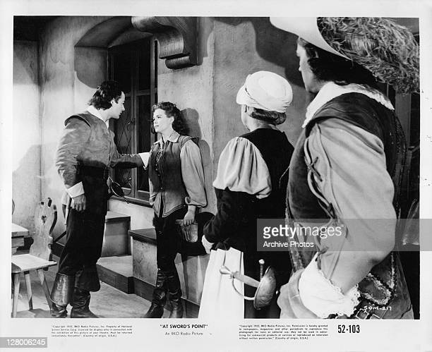 Cornel Wilde speaking with unidentified actress in a scene from the film 'At Sword's Point' 1952
